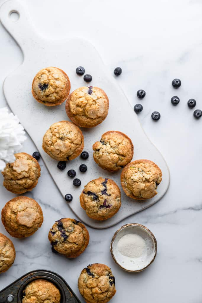 Zucchini Blueberry Muffins on a serving board