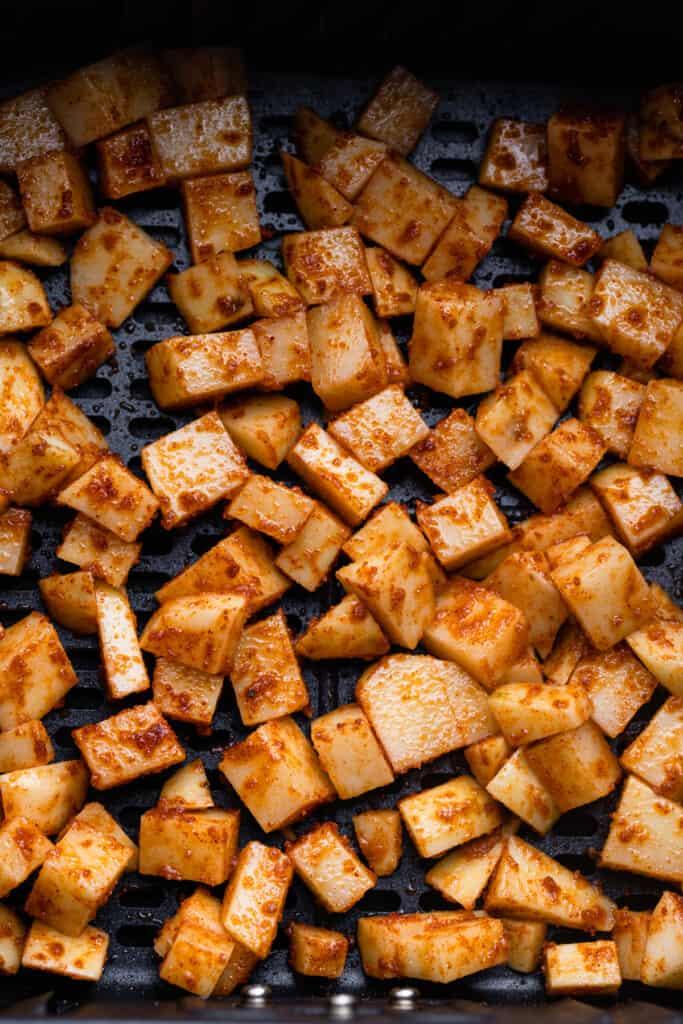 Air Fryer Breakfast Potatoes arranged in the air fryer