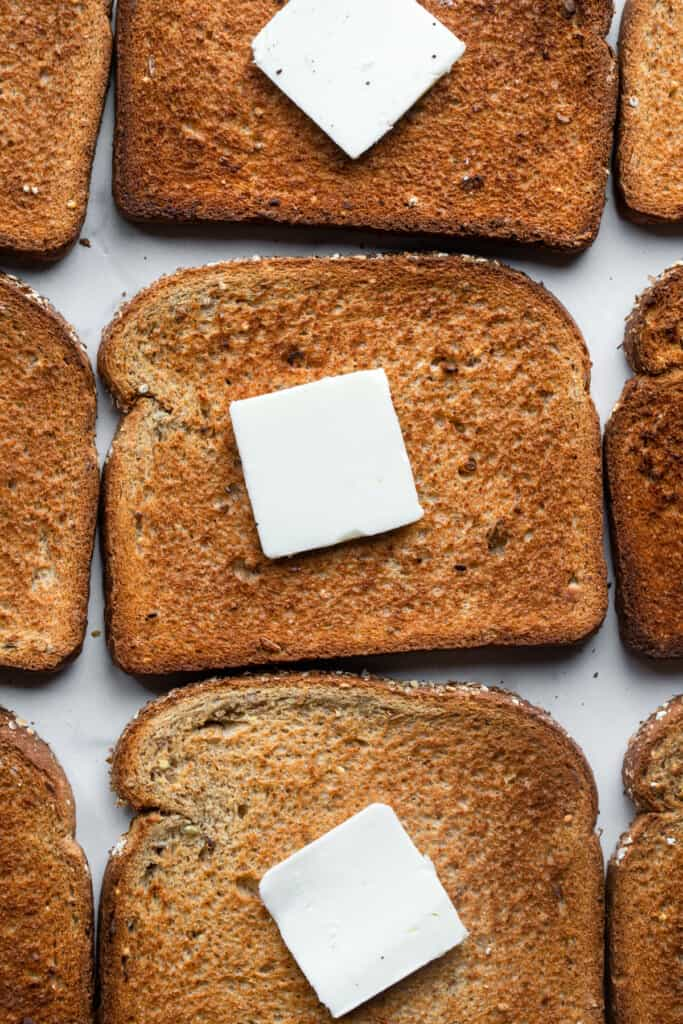 butter on a bunch of slices of Air Fryer Toast
