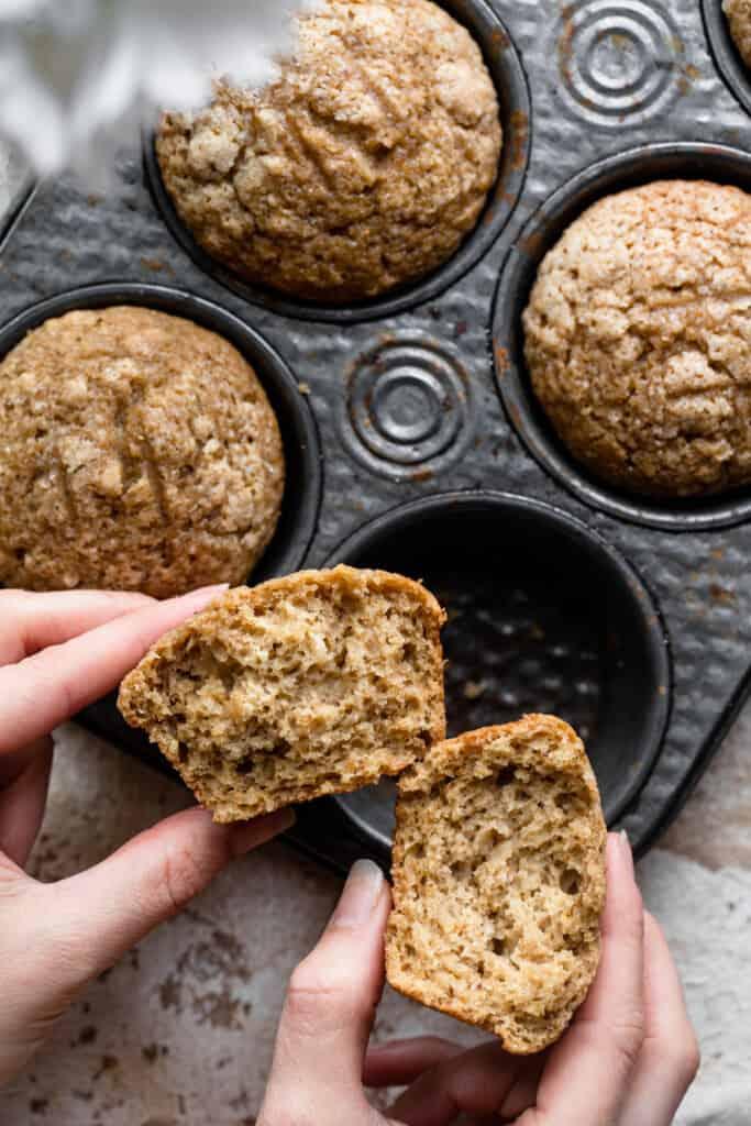 one Applesauce Muffins being broken in half