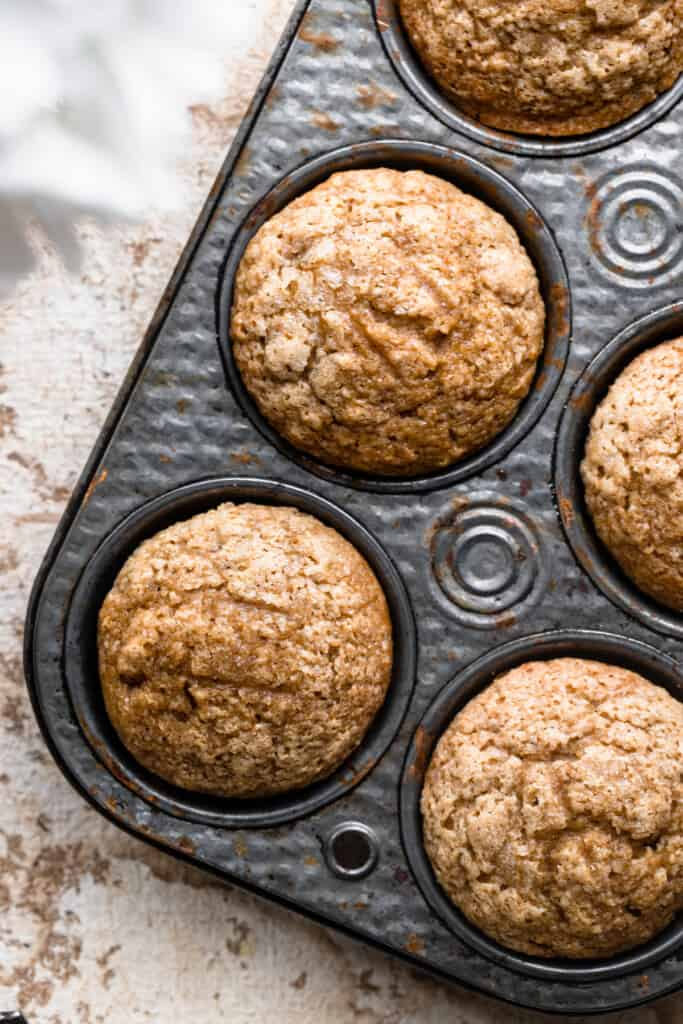 close up of Applesauce Muffins in a muffin pan