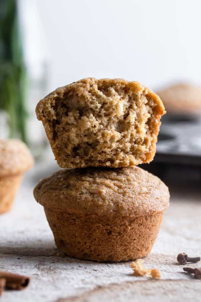 two Applesauce Muffins stacked on top of eachother