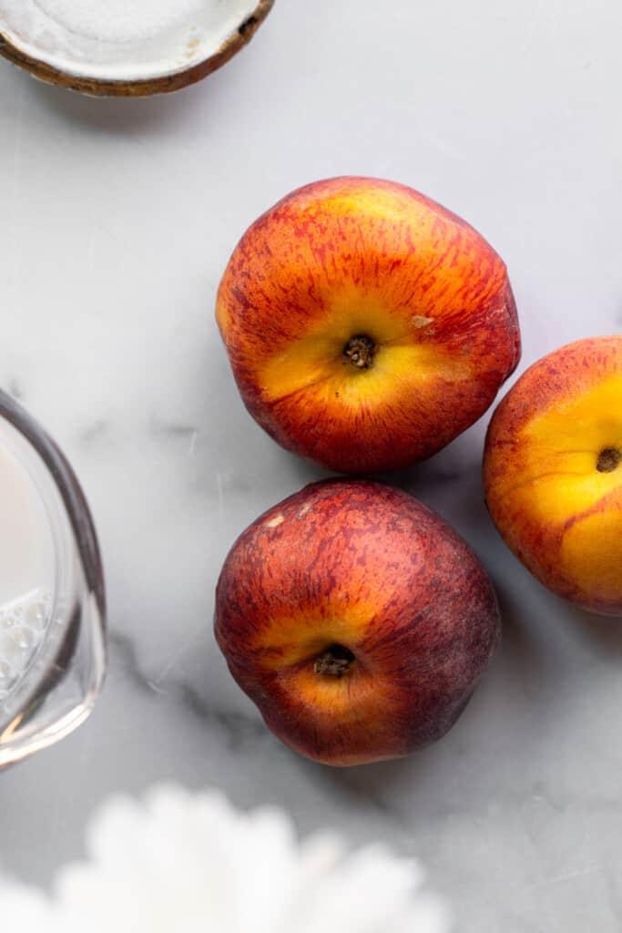 3 plump peaches ready for Peach Milk