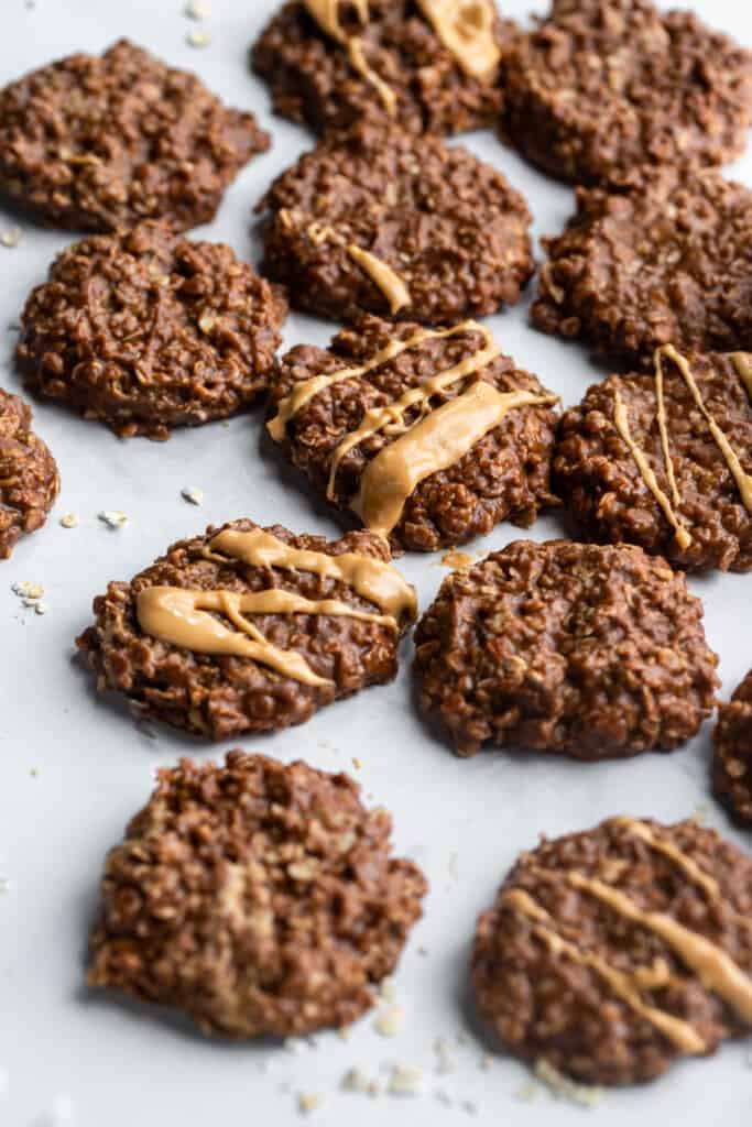 a batch of Vegan No Bake Cookies with peanut butter on top
