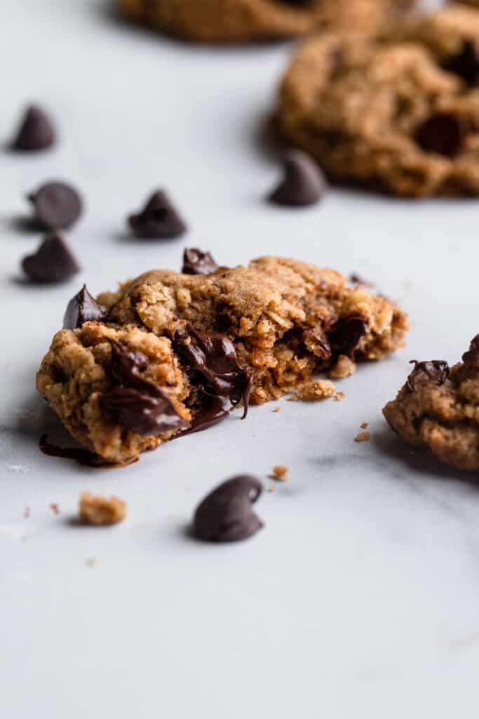 one Vegan Oatmeal Chocolate Chip Cookies cut in half