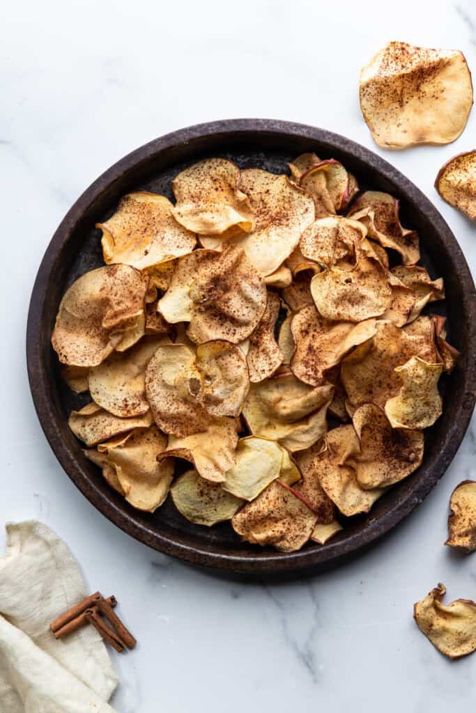 a serving bowl of Air Fryer Apple Chips