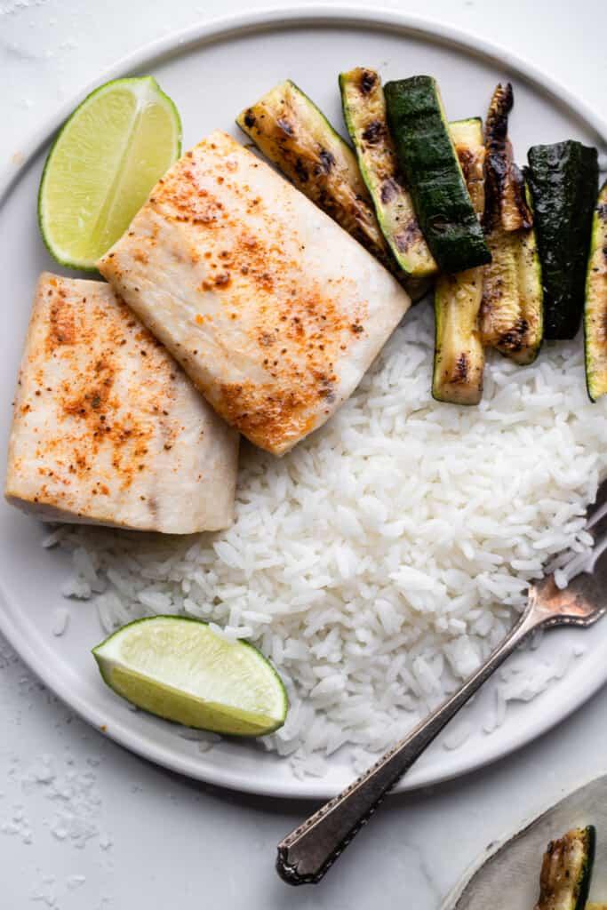 Air Fryer Mahi Mahi on a dinner plate with rice and zucchini