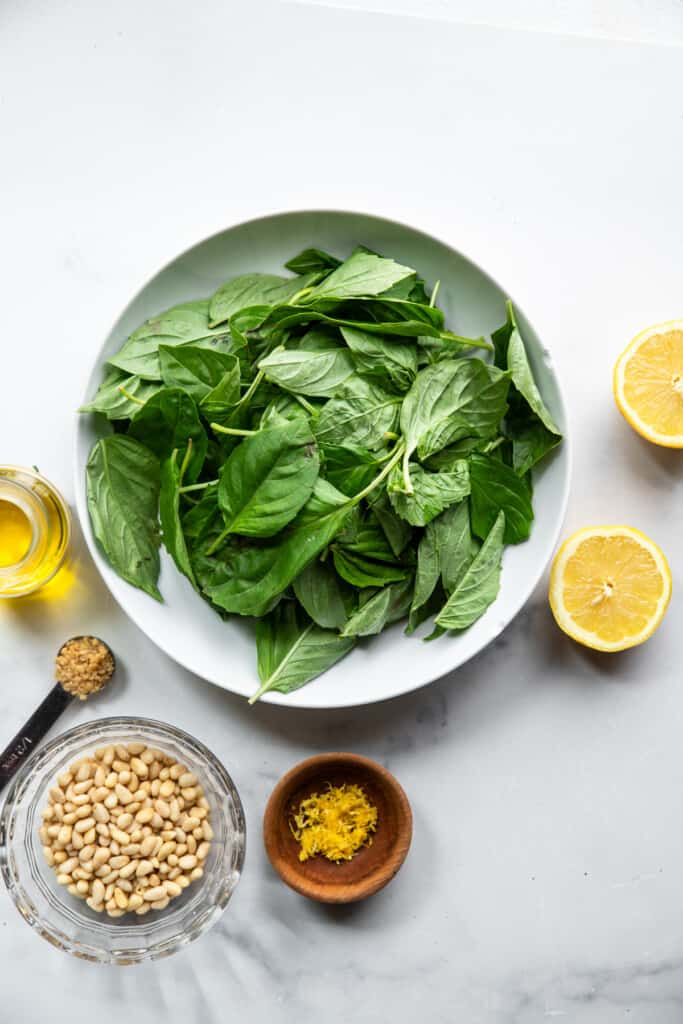 basil leaves in a bowl for Dairy Free Pesto