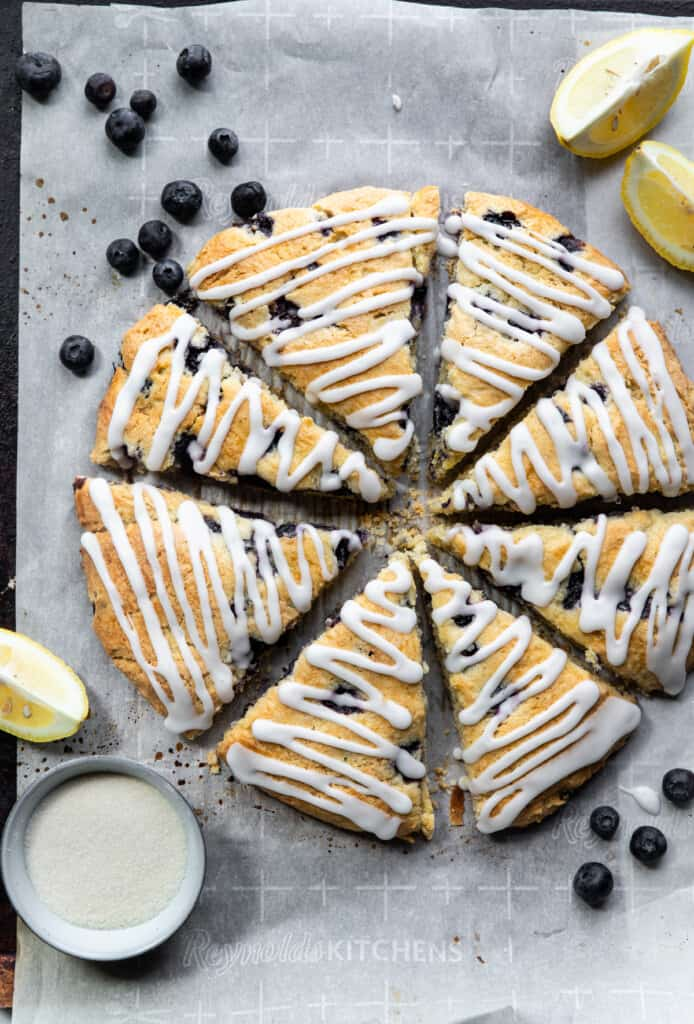 a batch of Gluten Free Scones with Blueberries on parchment paper