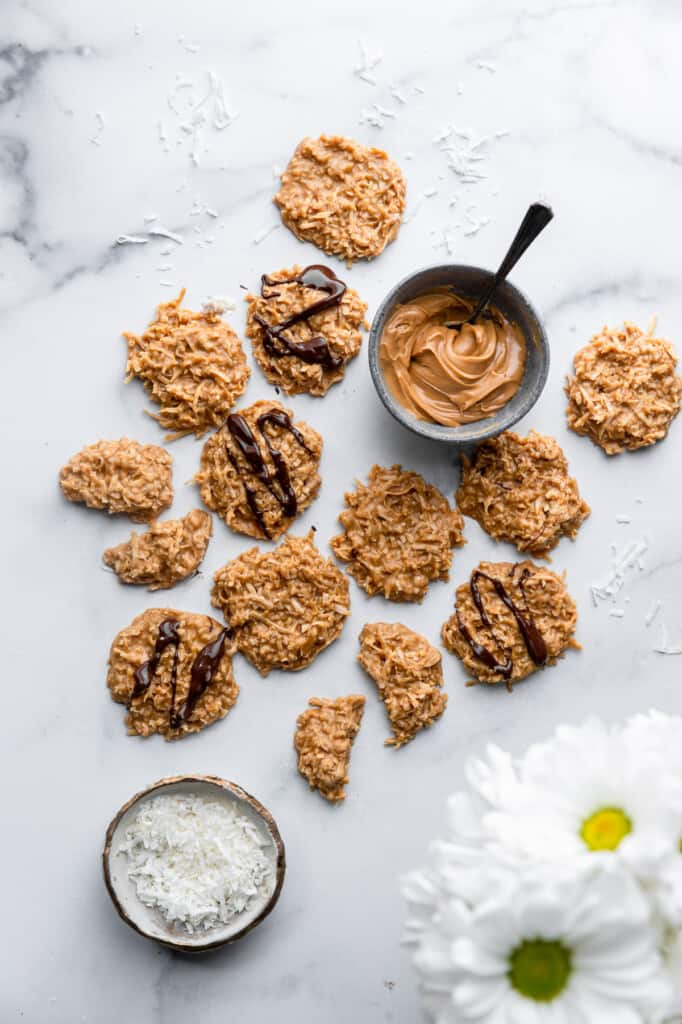 a batch of Keto No Bake Cookies on a table with toppings
