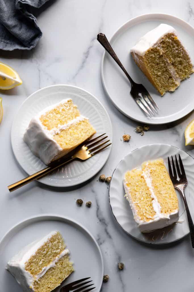 several slices of Vegan Lemon Cake on dessert plates