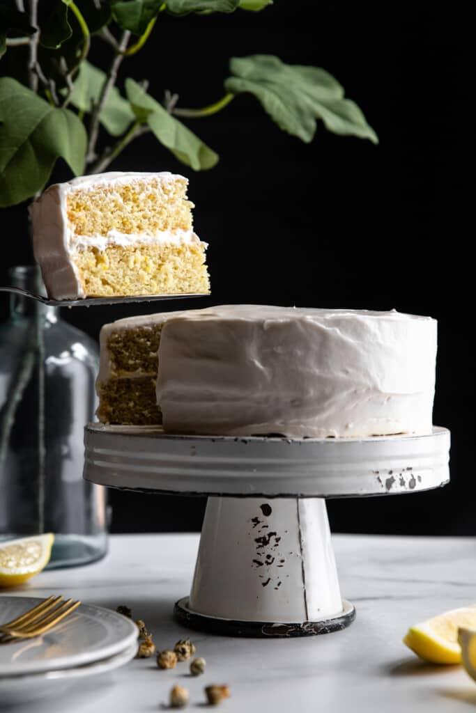 a whole Vegan Lemon Cake on a cake stand