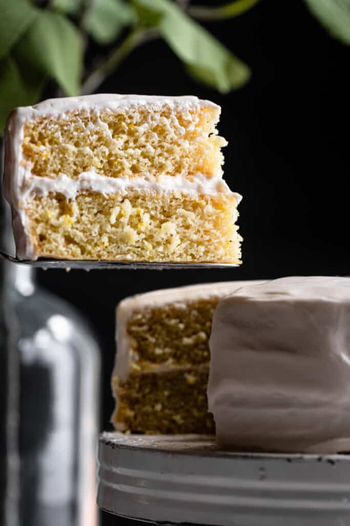 a slice of Vegan Lemon Cake being lifted with a cake slicer