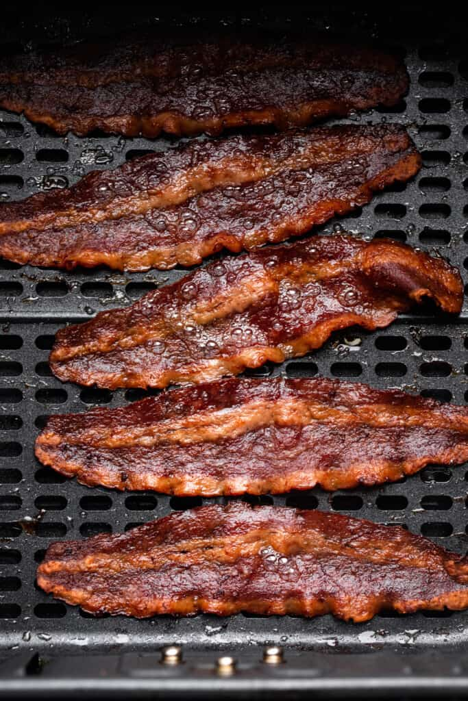 cooked Air Fryer Turkey Bacon on an air fryer tray