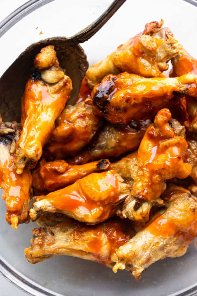 a bowl full of Air Fryer Chicken Wings with sauce