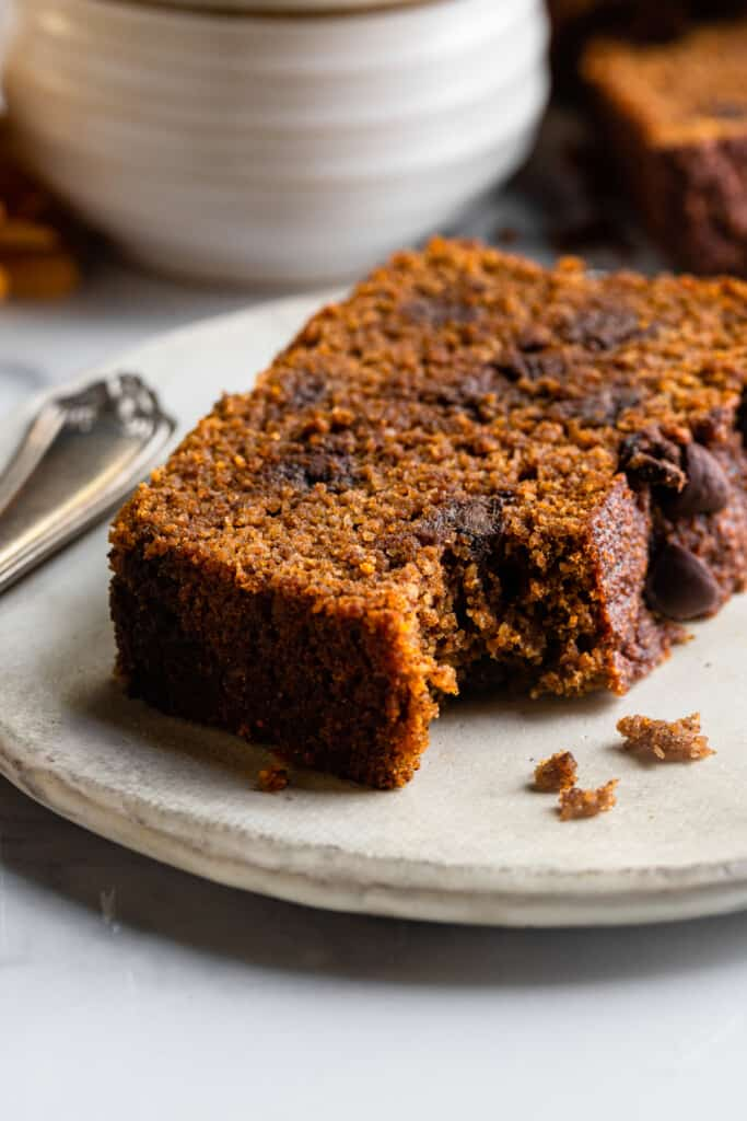 a slice of Almond Flour Pumpkin Bread with a bit missing