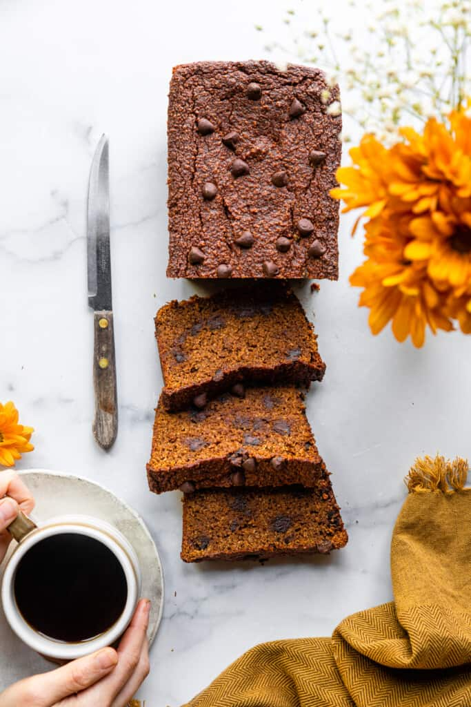 a full load of Almond Flour Pumpkin Bread on a table with a knife