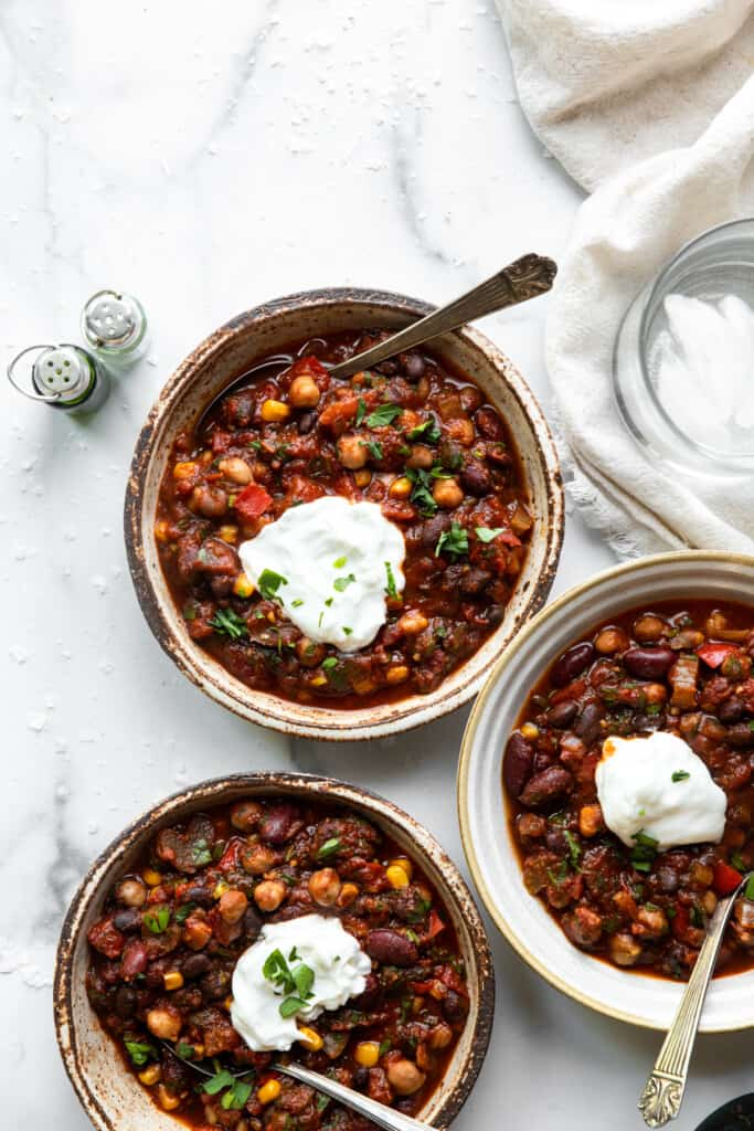 bowls of Crockpot Vegetarian Chili with sour scream