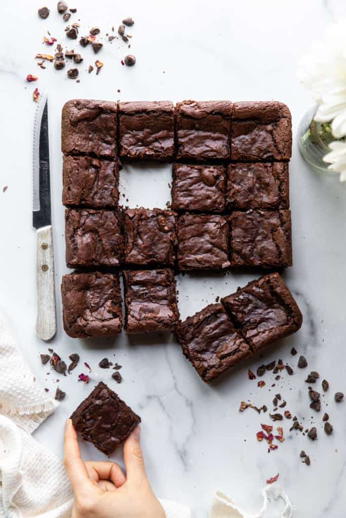 a batch of Eggless Brownies cut up with a knife
