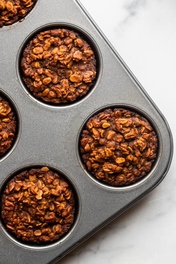 Pumpkin Oatmeal Muffins in a muffin pan