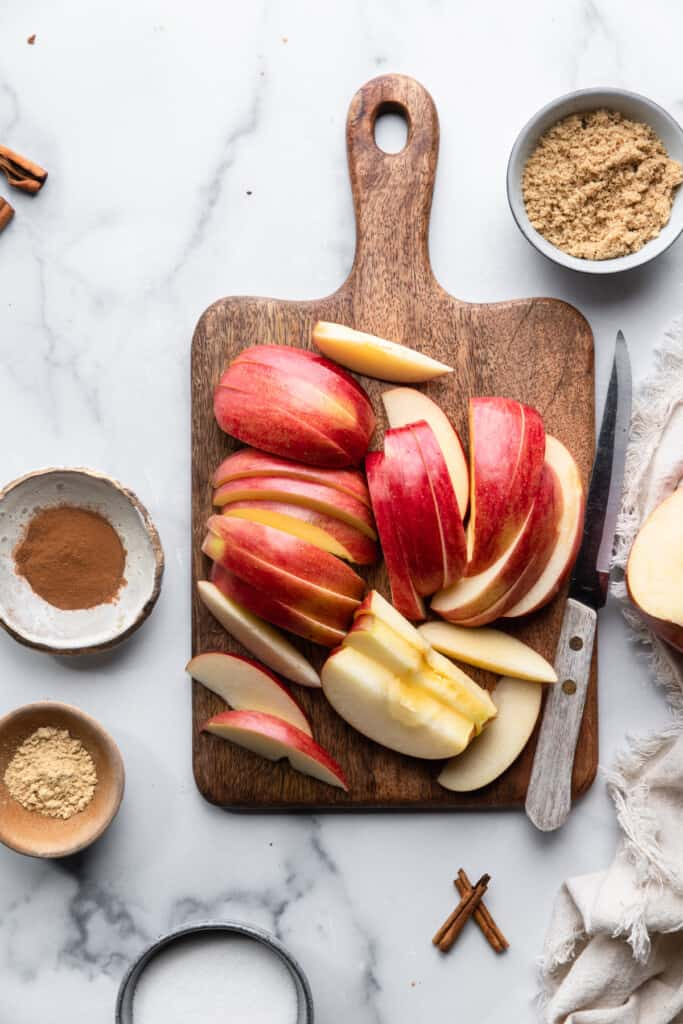 slices of apples on a cutting board for Slow Cooker Apple Butter