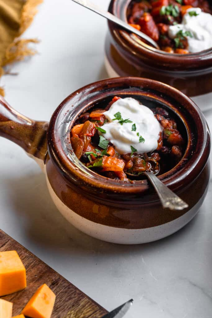 a small soup pot full of Butternut Squash Chili with sour cream