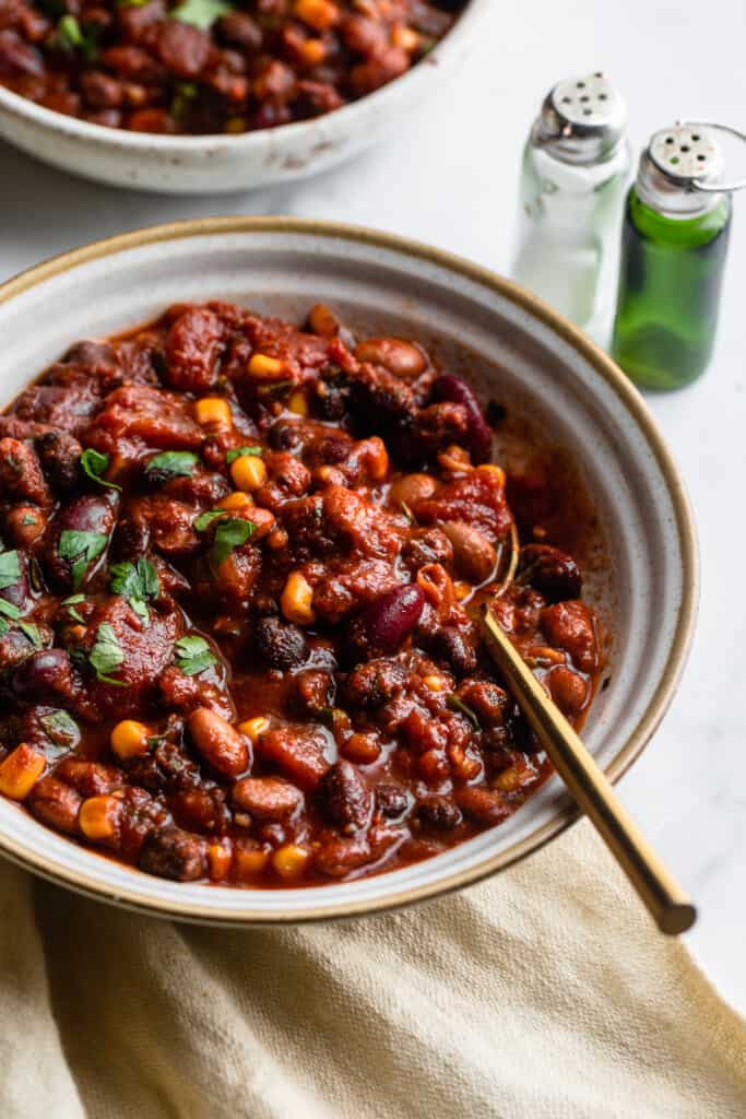 a large bowl of Crock Pot Bean Chili with a spoon